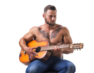 Topless handsome man playing guitar