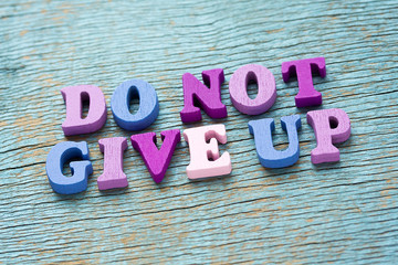 Do not give up phrase on vintage wooden background