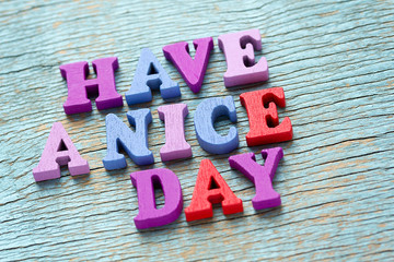 Have a nice day phrase on vintage wooden background