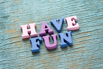 Have fun phrase on vintage wooden background