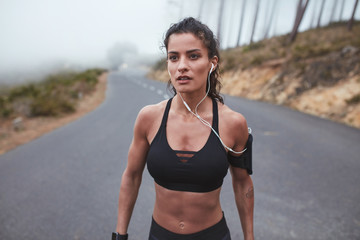 Muscular woman in sportswear on morning training session