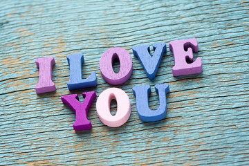 I love you phrase on vintage wooden background