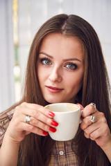girl drinks coffee