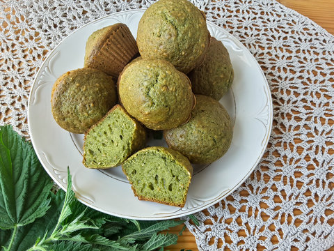 Nettles green muffins with ginger and cardamom on plate