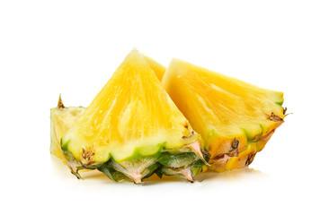 Slice of pineapple isolated