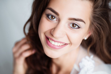 Portrait of smiling woman with perfect smile and white teeth looking at camera