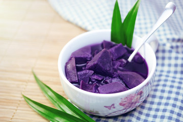 purple sweet potato in sweet soup, sweet potato boiled with ginger, brown sugar and pandan leaf, chinese dessert soup.