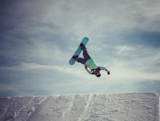 snowboarder jumps a superman backflip