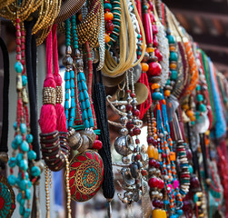 jewelry in row of necklaces and bracelets