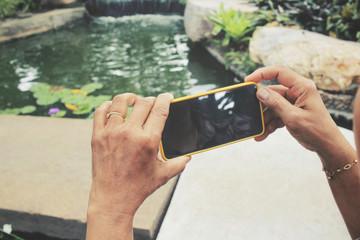 Senior woman take a photo wiht smart phone
