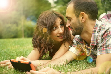 Couple of persons doing selfie in a park