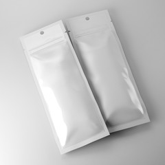 Blank foil bags on neutral background