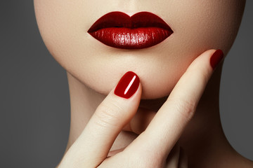 Red sexy lips and nails closeup. Open mouth. Manicure and make-up