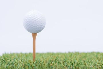 White Golf ball on green grass