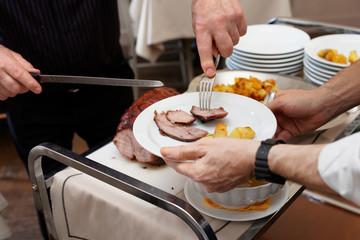 Chef is cutting beefsteak