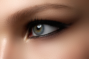 Creative eye makeup. Fashionable smoke eyes. Cosmetics and make-up
