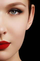 Make-up and cosmetics. Beauty woman face isolated on black background