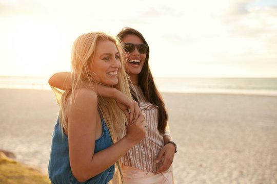 Best friends enjoying summer vacation on beach