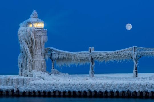 Ice accumulates on the St. Joseph North Pier Lighthouse in Saint Joseph, Michigan