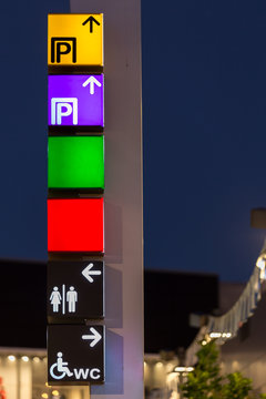 directional signs on a pole shopping center