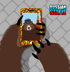 Russian bear selfie on red square. Wild bear and tower of Moscow