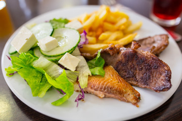 Fish and chips with salad on the plate