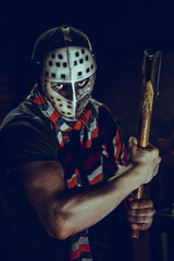 Portrait of Maniac with axe in dark basement