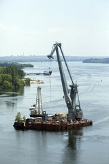 Floating crane in the river