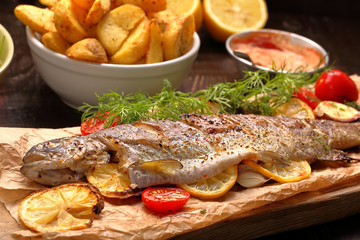 Baked fish with roasted potatoes and dip