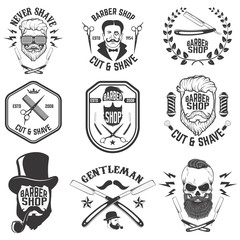 Barber shop emblems. Set of the barber tools. Different hairstyl