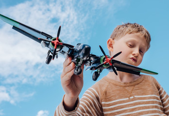Boy play with toy plane