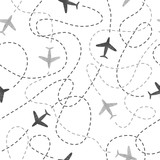 Seamless pattern with watercolor airplanes. Travel around the world concept. Vector background.