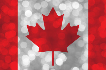 canada flag over bokeh background