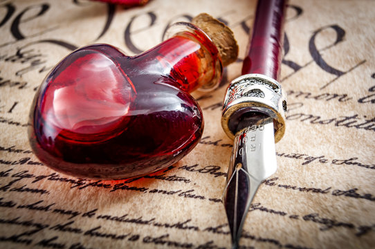 Vial of blood and a fountain pen on the US constitution, symbolising the blood that was spilled by America 's forefathers in the name of life, liberty and the pursuit of happiness