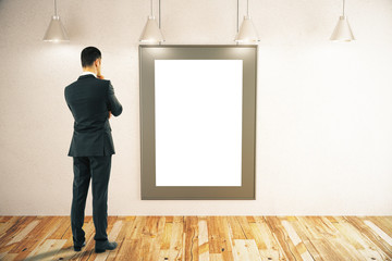 Man looking at picture frame
