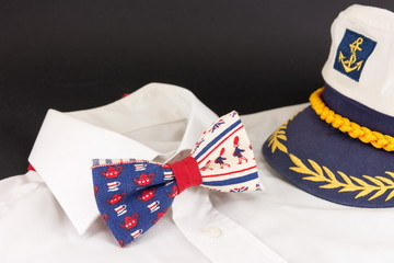 bow tie, shirt and a  captain's hat