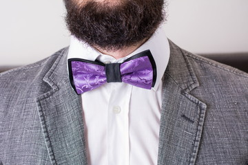 Bearded man in a suit and bow tie