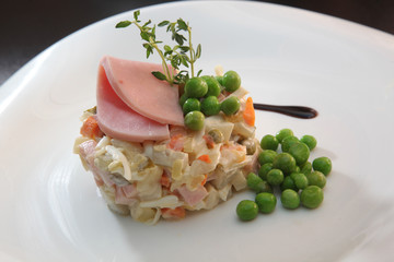 Russian salad with sausage