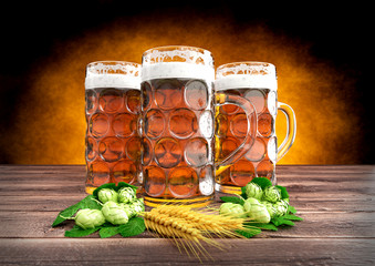 three glasses of oktoberfest beer with barley and hops - 3D render