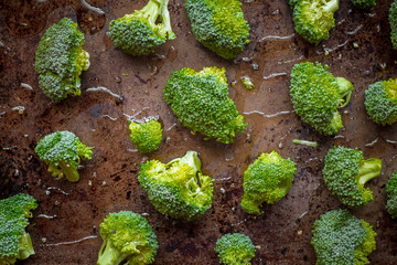 Broccoli florets on cooking pan with olive oil for recipe