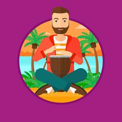 Man playing ethnic drum.