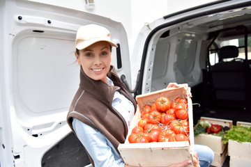 Cheerful farmer delivering fresh vegetables
