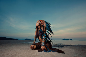 Indian woman outdoors at sunset. native american style. Backgrou