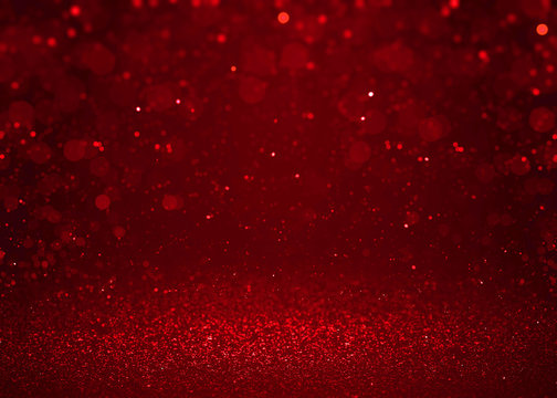 Red sparkle glitter abstract background.