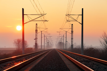 Railway at sunset with sun