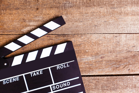 photo of movie clapper on wood