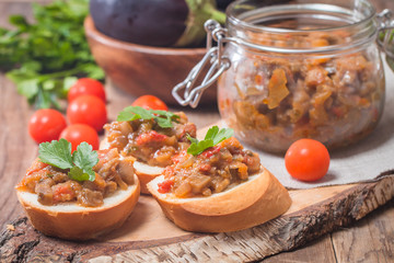 Eggplant caviar in a glass jar with croutons