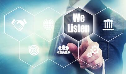 A businessman selecting a We Listen Concept button