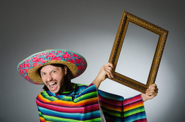 Mexican man with sombrero and picture frame