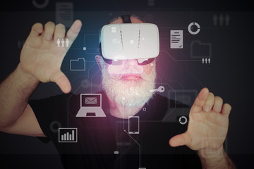 Aged man in virtual reality glasses zooming the virtual screen